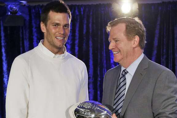 In this Feb. 2, 2015, file photo, New England Patriots quarterback Tom Brady poses with NFL Commissioner Rodger Goodell during a news conference after NFL football's Super Bowl XLIX in Phoenix, Ariz. Brady grew from a sixth-round draft choice into one of the best quarterbacks in NFL history. On Tuesday, NFL commissioner Roger Goodell hears Brady's appeal of a four-game suspension for using deflated footballs in the AFC championship game. How will that affect Brady's legacy?  (AP Photo/David J. Phillip, File)