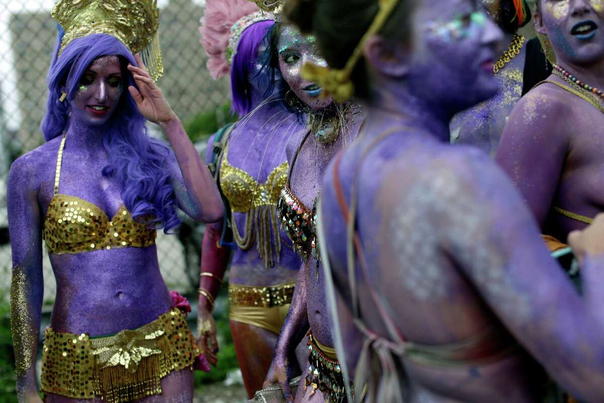 Tash's Mermaid Minions assemble before the start of the 33rd annual Mermaid Parade, Saturday, June 20, 2015, in Coney Island in the Brooklyn borough of New York.