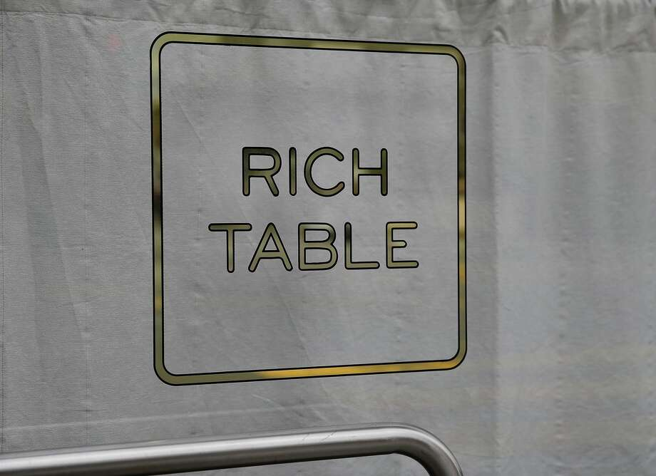 The finished sign for the Rich Table restaurant on Gough Street. Andrew Lawrence is the man behind Gentleman Scholar Signs.  He makes ornate, etched, gold-leaf window signs for San Francisco, Calif. restaurants. Photo: Brant Ward, The Chronicle