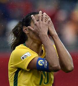 Brazil's midfielder Marta reacts to her teams' loss to Australia in their 2015 FIFA Women's World Cup round of 16 match at Moncton Stadium, in New Brunswick, Canada on June 21, 2015. AFP PHOTO / FRANCK FIFEFRANCK FIFE/AFP/Getty Images