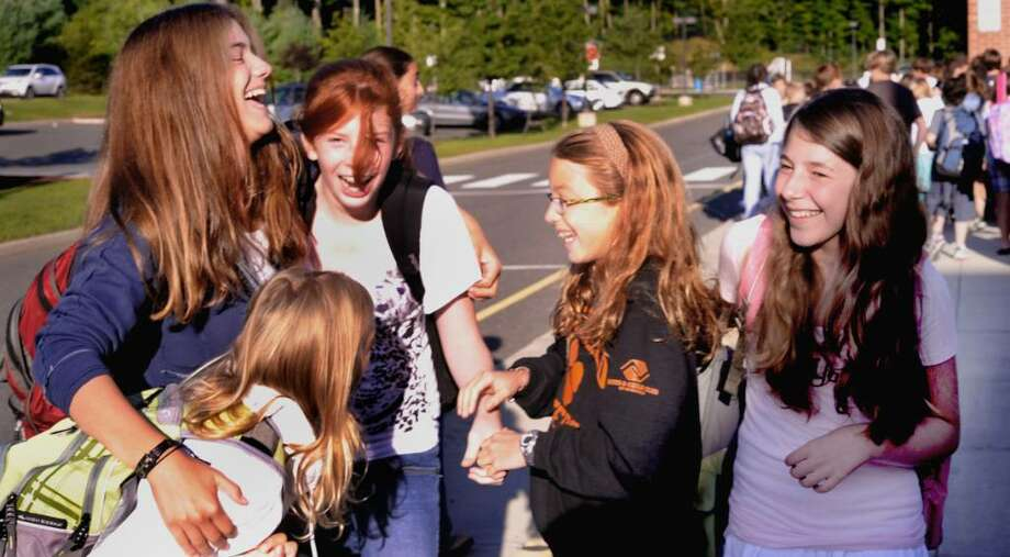 Lilly Returning seventh graders greet each other after getting off different busses outside Scotts Ridge Middle School in Ridgefield on the first day of classes, Sept. 1, 2009. From top left are: Emma Butturini, Lilly Whitmore, Eliza Wendel and Jacklyn Danbrousio. Photo: Michael Duffy / The News-Times