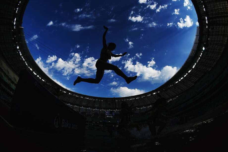 Athletes clear the water jump during the Women's 3000 metres steeplechase during day nine of the Baku 2015 European Games at the Olympic Stadium on June 21, 2015 in Baku, Azerbaijan. Photo: Matthias Hangst