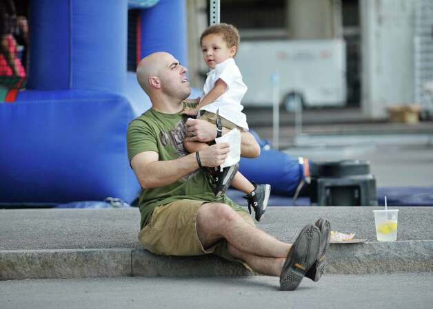 Adam Brace, left, of Albany plays with his nephew, Alijah Brace, 3, of Albany during Dad Fest on Sunday, June 21, 2015, in Albany, N.Y. The yearly Father's Day event is put on by the City of Albany.    (Paul Buckowski / Times Union) Photo: PAUL BUCKOWSKI / 00031889A