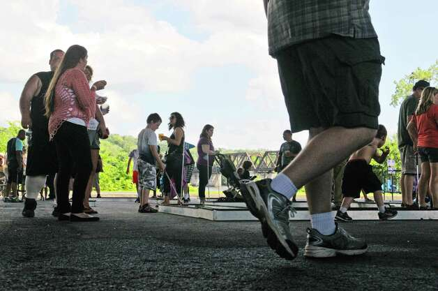Adults and children play miniature golf at the Corning Preserve during Dad Fest on Sunday, June 21, 2015, in Albany, N.Y. The yearly Father's Day event is put on by the City of Albany.    (Paul Buckowski / Times Union) Photo: PAUL BUCKOWSKI / 00031889A