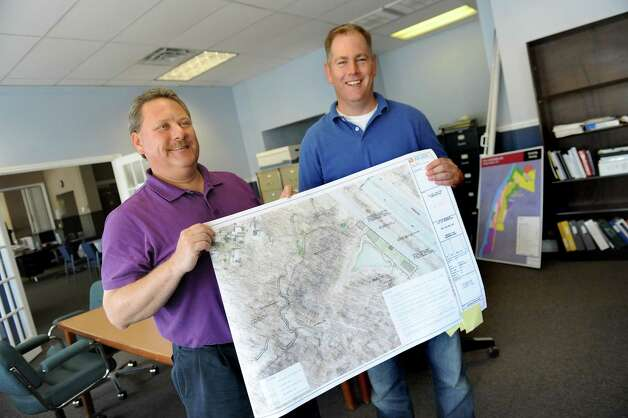 Engineer David Hiss, left, and City Planning Director Charles Moore hold plans for the Hollow Park on Wednesday, June 17, 2015, at City Hall in Rensselaer, N.Y. (Cindy Schultz / Times Union) Photo: Cindy Schultz / 00032288A