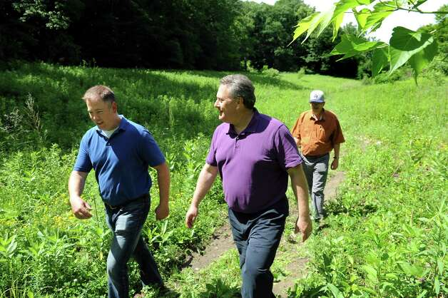 City Planning Director Charles Moore, left, joins engineer David Hiss, center, and engineer aide Mark Hendrick on Wednesday, June 17, 2015, at the future Hollow Park in Rensselaer, N.Y. (Cindy Schultz / Times Union) Photo: Cindy Schultz / 00032288A