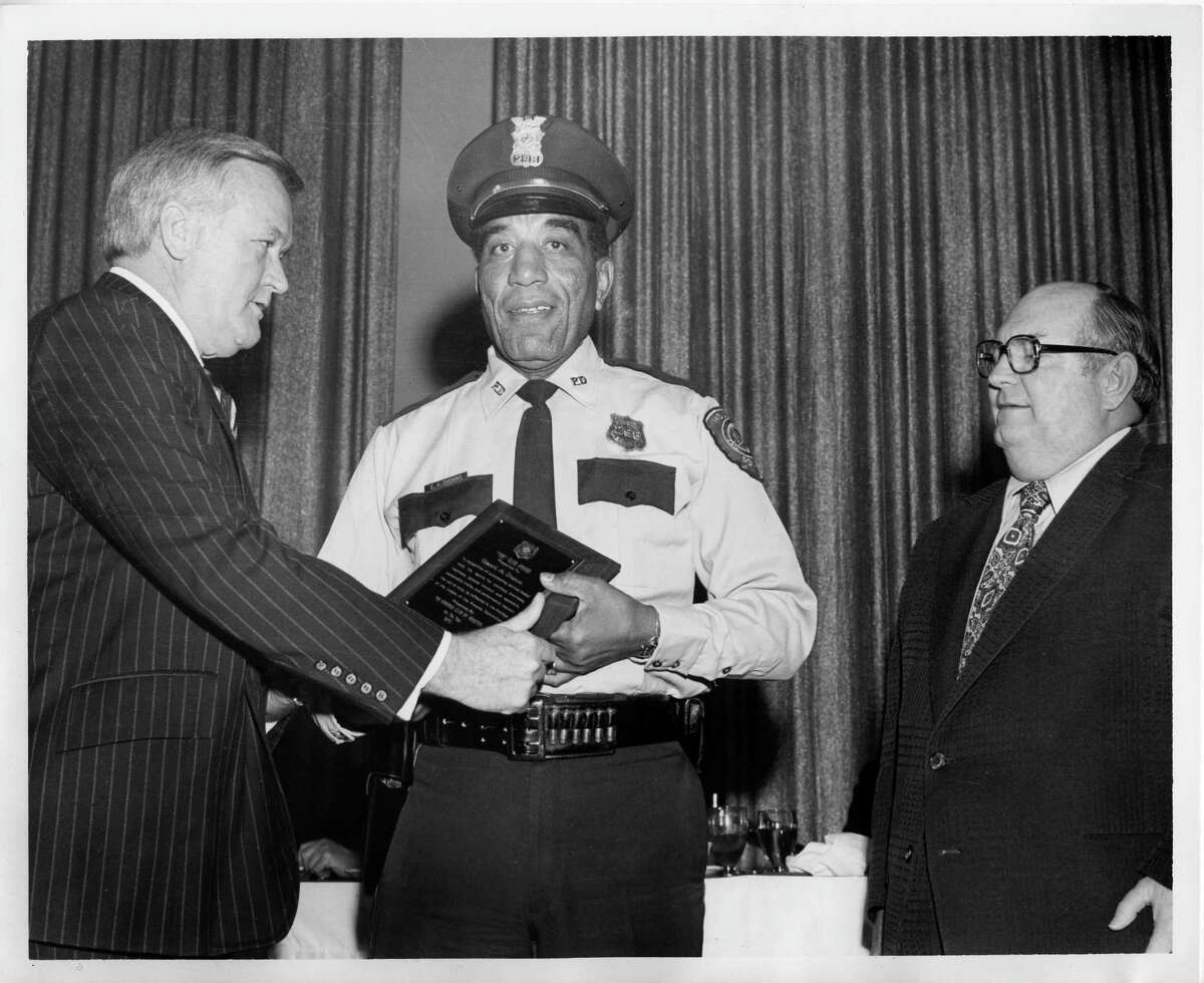 Houston Police announced Monday, Aug. 10, 2015 that retired officer Edward A. Thomas died at age 95 of natural causes. Here, he is honored as Officer of the Year by the 100 Club in 1976. Last week, Police Chief Charles McClelland Jr. suggested honoring him further - as the namesake of HPD's headquarters.