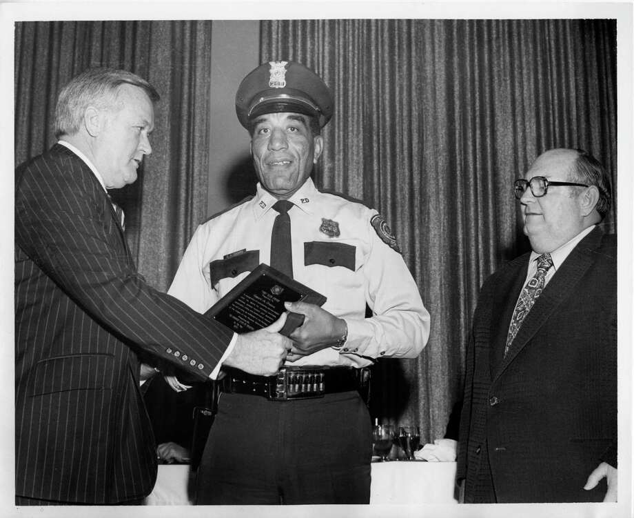Houston Police announced Monday, Aug. 10, 2015 that retired officer Edward A. Thomas died at age 95 of natural causes. Here, he is honored as Officer of the Year by the 100 Club in 1976. Last week, Police Chief Charles McClelland Jr. suggested honoring him further - as the namesake of HPD's headquarters.  Photo: Photo Courtesy Of The Houston Po / Photo courtesy of the Houston Po