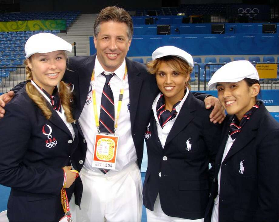 Ronda Rousey, left, is shown with Jason Morris, second from left, as well as Valerie Gotay, second from right, and Sayaka Matsumoto. All were part of the U.S. Olympic women's judo team in 2008. (Photo courtesy Jason Morris)