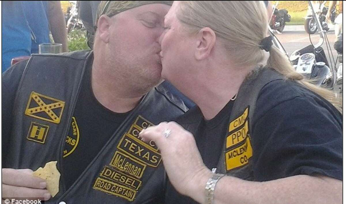 """Danny """"Diesel"""" Boyett leans in for a kiss with his wife, Nina, at a Cossacks Motorcycle Club gathering before he was shot and killed in Waco."""