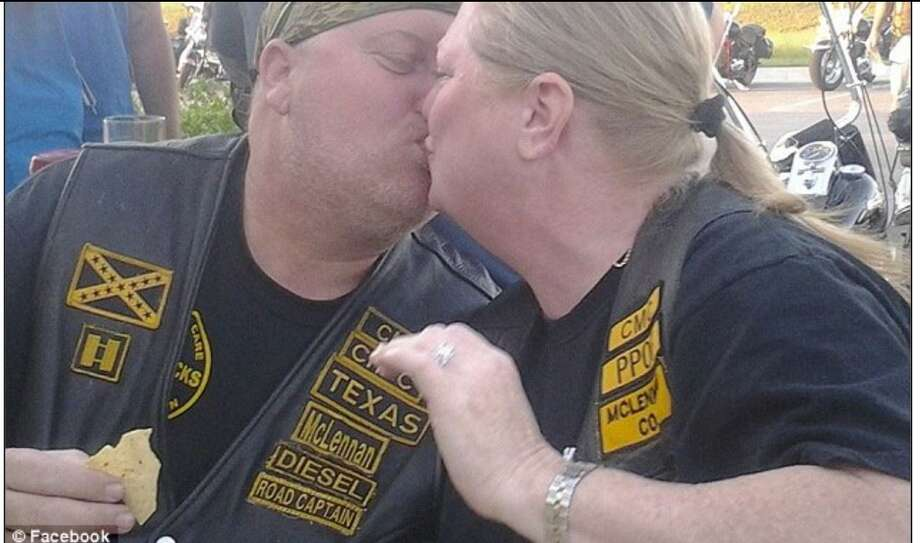 "Danny ""Diesel"" Boyett leans in for a kiss with his wife, Nina, at a Cossacks Motorcycle Club gathering before he was shot and killed in Waco. Photo: Courtesy By The Boyett Family / courtesy by the Boyett family"