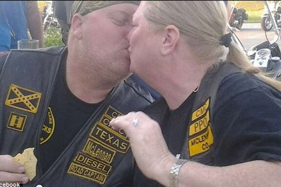"Danny ""Diesel"" Boyett leans in for a kiss with his wife, Nina, at a Cossacks Motorcycle Club gathering before he was shot and killed in Waco."