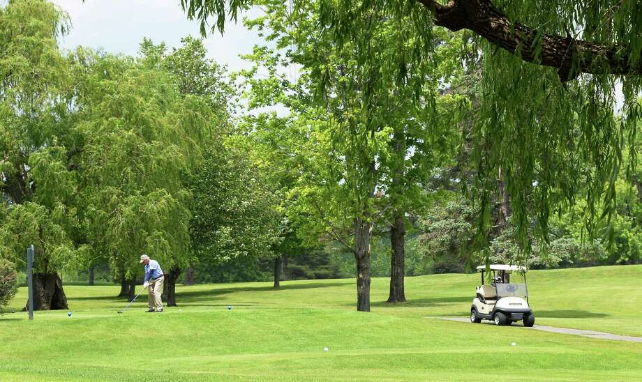 A golfer plays at Normanside Country Club on June 9, 2015, in Bethlehem.  (John Carl D'Annibale / Times Union) Photo: John Carl D'Annibale / 00032222A