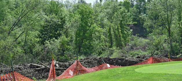 Mounds of dirt still cover the area near the creek bed that separates Normanside Country Club and the Capital Hills Golf Course on June 10, 2015       (Skip Dickstein/Times Union) Photo: SKIP DICKSTEIN