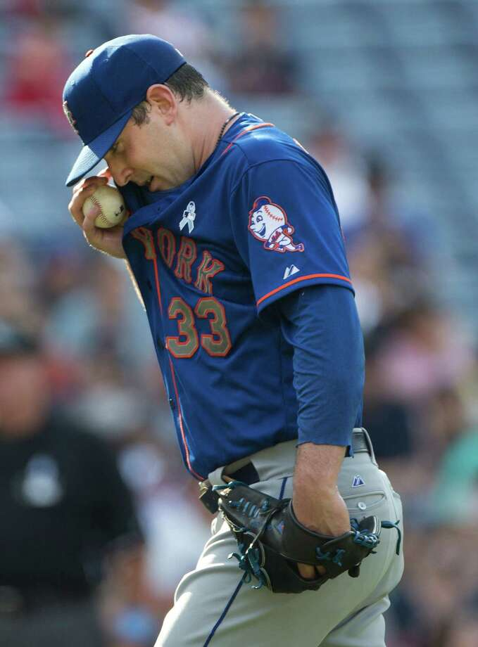 New York Mets starting pitcher Matt Harvey (33) wipes his face as he pinches in the fifth inning of a baseball game against the Atlanta Braves Sunday, June 21, 2015, in Atlanta.  Atlanta won 1-0. (AP Photo/John Bazemore)   ORG XMIT: GAJB111 Photo: John Bazemore / AP