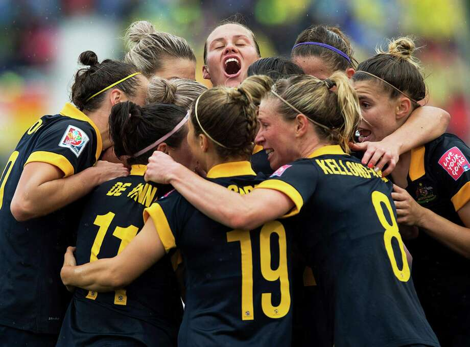 Australia players celebrate after Kyah Simon scored against Brazil during second-half FIFA Women's World Cup soccer game action in Moncton, New Brunswick, Canada, Sunday, June 21, 2015. (Andrew Vaughan/The Canadian Press via AP) MANDATORY CREDIT ORG XMIT: XAV106 Photo: Andrew Vaughan / The Canadian Press