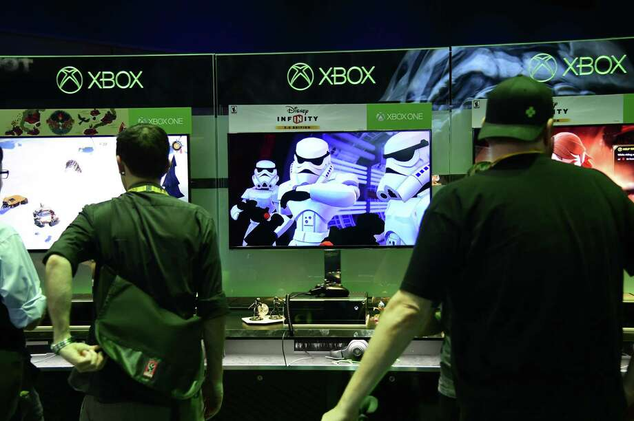 "Attendees watch demos for ""Disney Infinity 3.0"" an action-adventure sandbox ""toys to life"" video game with Star Wars characters, at the E3 Electronic Entertainment Expo in Los Angeles. Photo: Robyn Beck /Getty Images / AFP"
