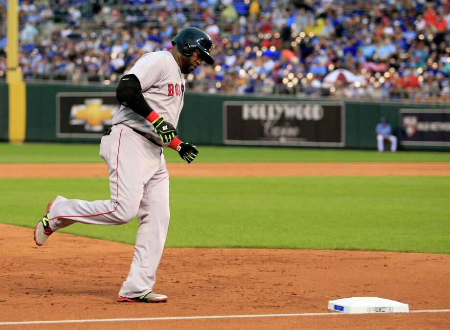 Boston Red Sox designated hitter David Ortiz rounds the bases after hitting a solo home run in the fourth inning of a baseball game against the Kansas City Royals at Kauffman Stadium in Kansas City, Mo., Sunday, June 21, 2015. (AP Photo/Colin E. Braley) ORG XMIT: MOCB106 Photo: Colin E. Braley / FR123678 AP