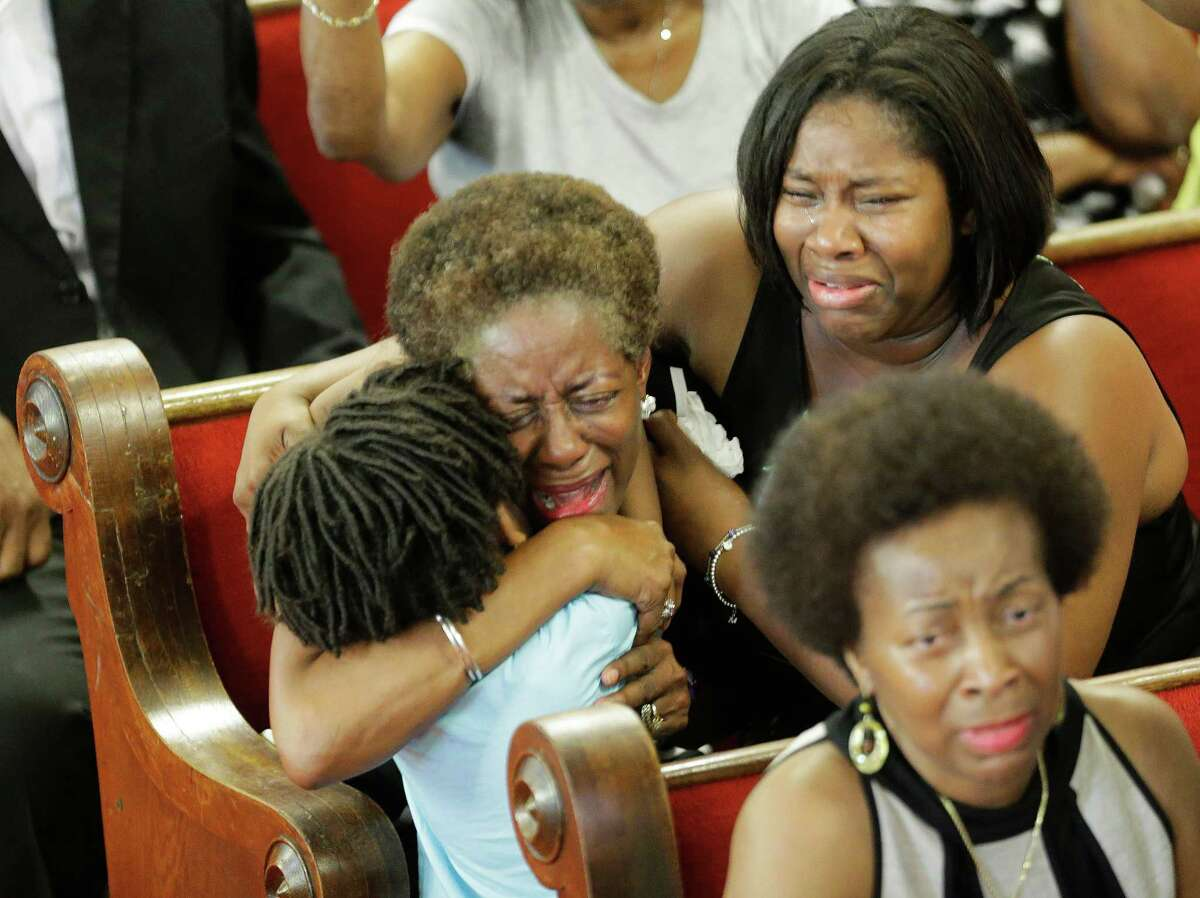 4100 x 3068~~$~~Parishioners pray and weep during services at the Emanuel A.M.E. Church Sunday, June 21, 2015, in Charleston, S.C., four days after a mass shooting that claimed the lives of it's pastor and eight others.