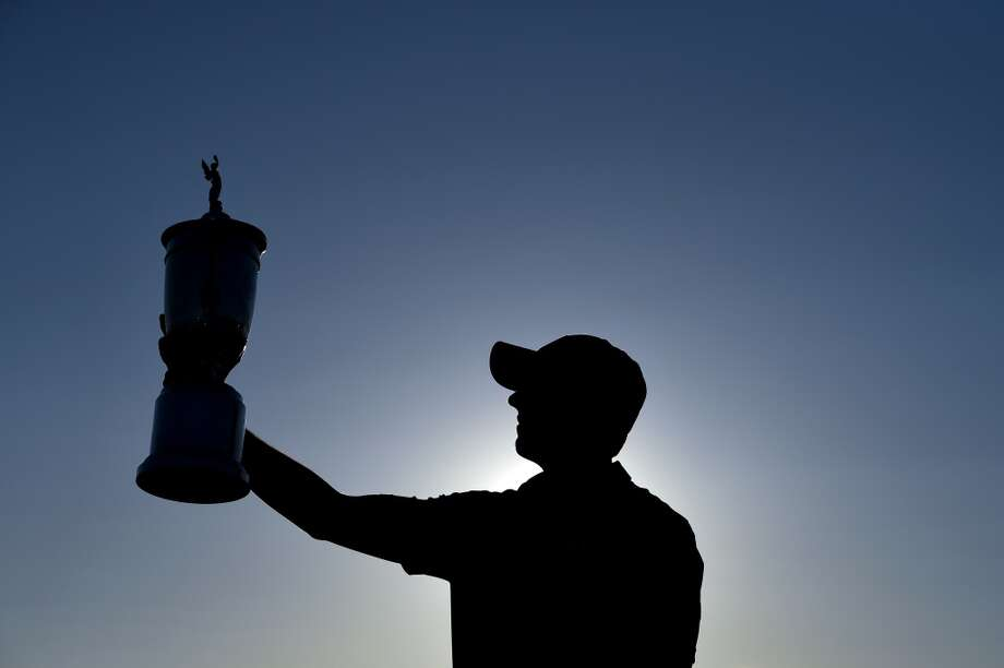 UNIVERSITY PLACE, WA - JUNE 21:  Jordan Spieth of the United States poses with the trophy for photographers after winning the 115th U.S. Open Championship at Chambers Bay on June 21, 2015 in University Place, Washington.  (Photo by Ross Kinnaird/Getty Images) Photo: Ross Kinnaird, Getty Images