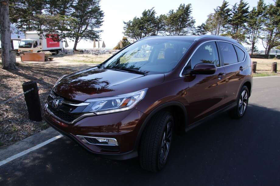 The 2015 Honda CR-V all-wheel-drive Touring crossover. Price: $33,600. Fuel economy: 26/33 mpg, city/highway. (Photos by Michael Taylor)