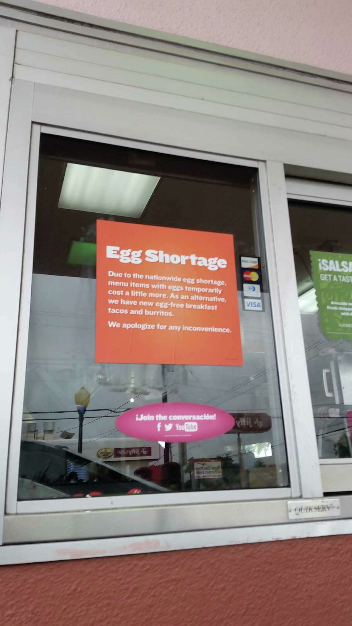 A sign at a Taco Cabano on Fredericksburg Road tells customers that the prices of egg dishes have risen and that eggless breakfast tacos and burritos have been added.