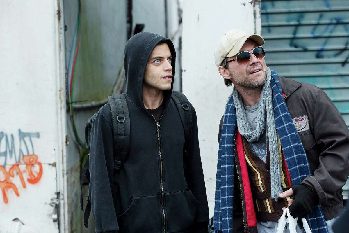 Rami Malek, left, as Elliot and Christian Slater as Mr. Robot in USA Network's 'Mr. Robot,' a thriller about high-tech hackers.