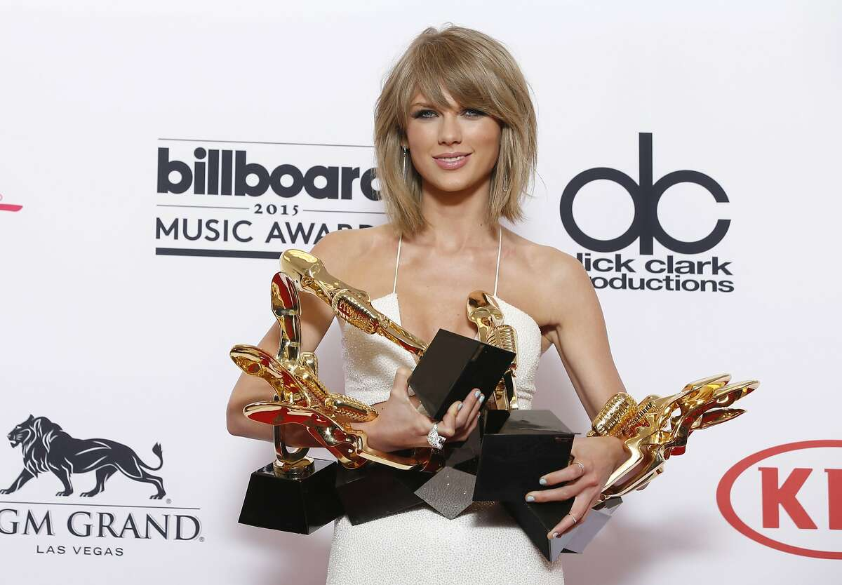FILE - In a May 17, 2015 file photo, Taylor Swift poses in the press room with the awards for top Billboard 200 album for