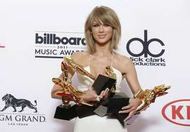 "FILE - In a May 17, 2015 file photo, Taylor Swift poses in the press room with the awards for top Billboard 200 album for ""1989"", top female artist, chart achievement, top artist, top Billboard 200 artist, top hot 100 artist, top digital song artist, and top streaming song (video) for ""Shake It Off"" at the Billboard Music Awards at the MGM Grand Garden Arena, in Las Vegas. In an open letter to Apple, on Sunday, June 21, 2015, Swift  criticized the company's new streaming music service for failing to pay artists for a free three-month trial. Swift said she would withhold her 2014 album ""1989"" from Apple Music, which launches June 30. (Photo by Eric Jamison/Invision/AP, File)"