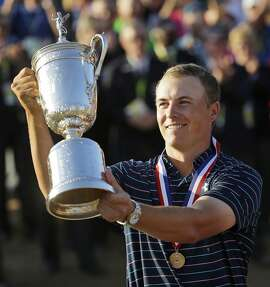 FILE - In this Sunday, June 21, 2015, file photo, Jordan Spieth holds up the trophy after winning the U.S. Open golf tournament at Chambers Bay in University Place, Wash. Spieth loves golf history, which is appropriate for someone quickly becoming part of it. He is halfway home to the Grand Slam.  (AP Photo/Ted S. Warren, File)