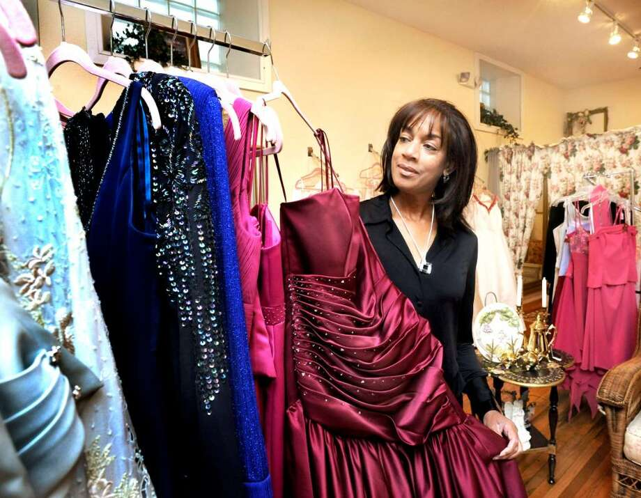 Karen Hartmann looks at gowns in the Danbury shop Elisabeth Adams Bridal Boutique on Aug. 28, 2009. Photo: Michael Duffy / The News-Times