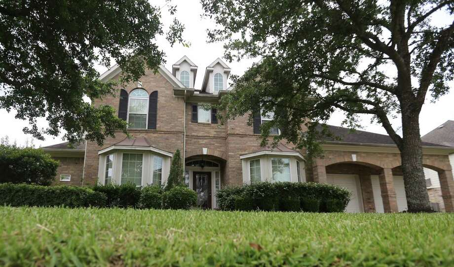The 11500 block of Island Breeze Street where former MLB player Darryl Hamilton was found dead Sunday, June 21, 2015 following an apparent murder suicide. Photo taken Monday, June 22, 2015 in Pearland. (Mayra Beltran / Houston Chronicle) Photo: Mayra Beltran | Houston Chronicle