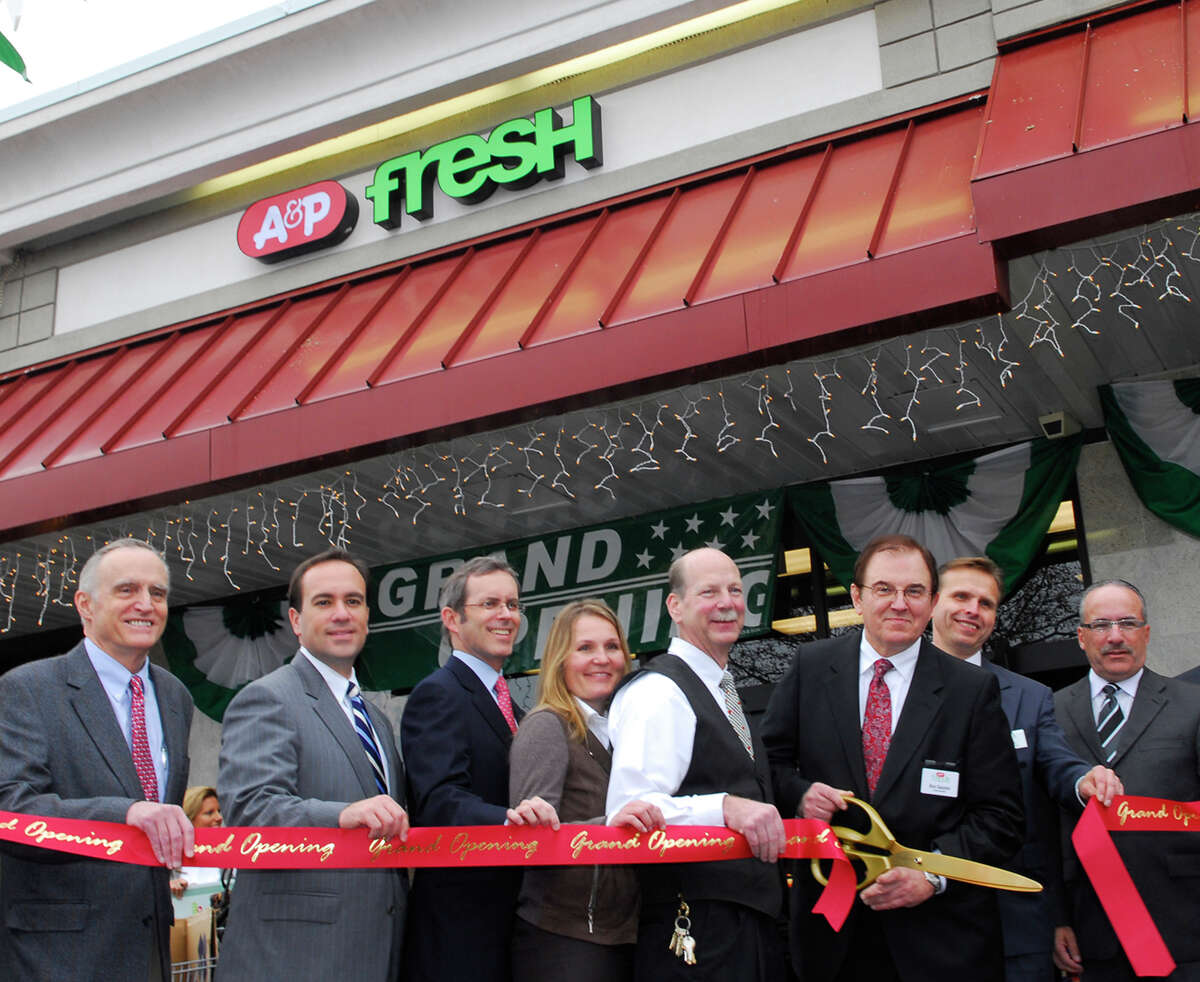 Christian Haub, third from left, helped preside at the 2008 opening of A&P Fresh in the Riverside neighborhood of Greenwich, Conn., where Haub is a resident. Haub served as executive chairman and CEO of A&P. Bob Luckey/Staff Photo