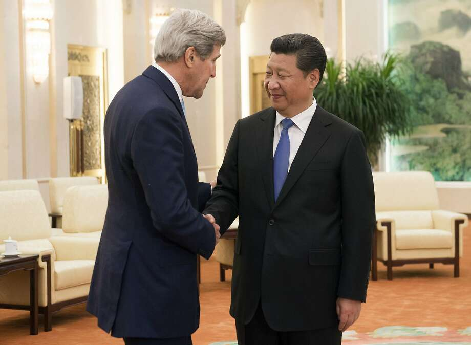 FILE - In this May 17, 2015, file photo, Chinese President Xi Jinping, right, and U.S. Secretary of State John Kerry shake hands prior to a meeting at the Great Hall of the People in Beijing, China. Tensions between the U.S. and China are growing over its island-building in the South China Sea and over suspicions that Beijing was behind a massive hack into a federal government server that resulted in the theft of personnel and security clearance records of 14 million employees and contractors.  (Saul Loeb/Pool Photo via AP, File) Photo: Saul Loeb, Associated Press