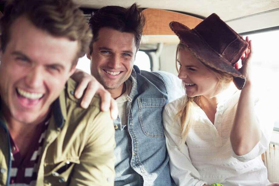 Friends enjoying road trip in a camper van Photo: Cultura/Christin Rose, Getty Images / Christin Rose