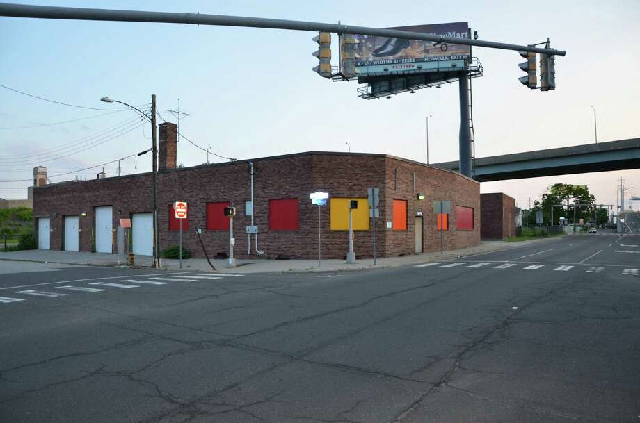 A warehouse at 363 Warren St. in Bridgeport, under the ramp connecting Interstate 95 with Route 8, has been proposed as a brewpub/pizza restaurant. Photo: Contributed / Contributed Photo / Connecticut Post Contributed