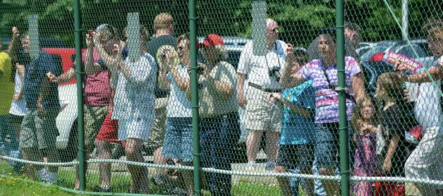 Spectators gather for a view of Boeing B-29 Superfortress ?Fifi? Monday, June 22, 2015, at Albany International Airport in Colonie, N.Y. The historic WWII bomber is the only flying example of its kind. The plane is viewable to the public between 9 a.m. and 5 p.m. Tuesday at the Million Air terminal at Albany International Airport. (Will Waldron/Times Union) Photo: WW / 00032287A