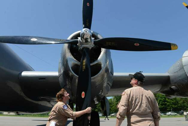 Crew members Daniel Carner, left, and Steve Colman moves one of the propellers on the Boeing B-29 Superfortress ?Fifi? Monday, June 22, 2015, at Albany International Airport in Colonie, N.Y. The historic WWII bomber is the only flying example of its kind. The plane is viewable to the public between 9 a.m. and 5 p.m. Tuesday at the Million Air terminal at Albany International Airport. (Will Waldron/Times Union) Photo: WW / 00032287A