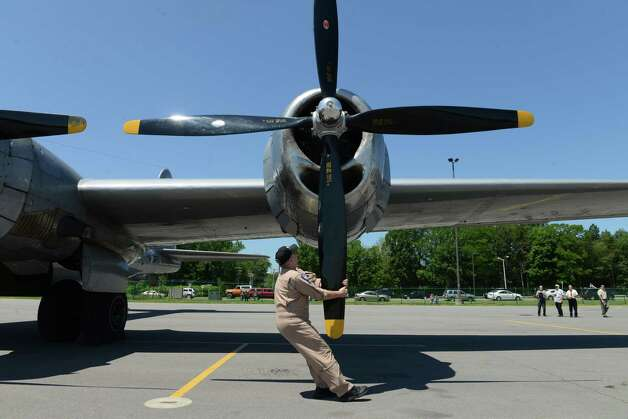 Crew member Steve Colman moves one of the propellers on the Boeing B-29 Superfortress ?Fifi? Monday, June 22, 2015, at Albany International Airport in Colonie, N.Y. The historic WWII bomber is the only flying example of its kind. The plane is viewable to the public between 9 a.m. and 5 p.m. Tuesday at the Million Air terminal at Albany International Airport. (Will Waldron/Times Union) Photo: WW / 00032287A