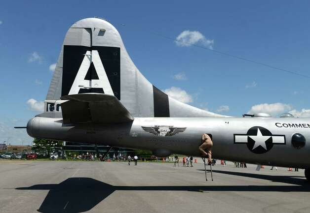 Crew member Daniel Carner emerges from the tail section of Boeing B-29 Superfortress ?Fifi? Monday, June 22, 2015, at Albany International Airport in Colonie, N.Y. The historic WWII bomber is the only flying example of its kind. The plane is viewable to the public between 9 a.m. and 5 p.m. Tuesday at the Million Air terminal at Albany International Airport. (Will Waldron/Times Union) Photo: WW / 00032287A