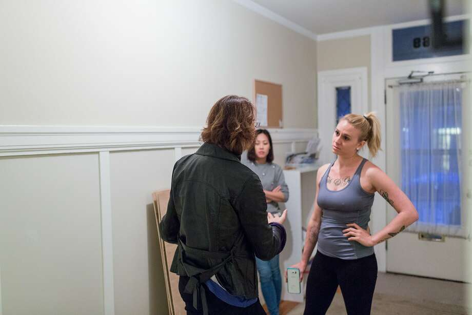 Katieanne Moran, right, and Jil Lin, center, confront their landlord about grievances after she stopped by unannounced at their shared apartment in San Francisco, Calif., Wednesday, June 10, 2015. Five people live in the Nob Hill victorian flat but complain that their landlady is renting units above and below on Airbnb, violating city codes, creating a nuisance and a security risk for longterm tenants. Photo: Jason Henry, Special To The Chronicle