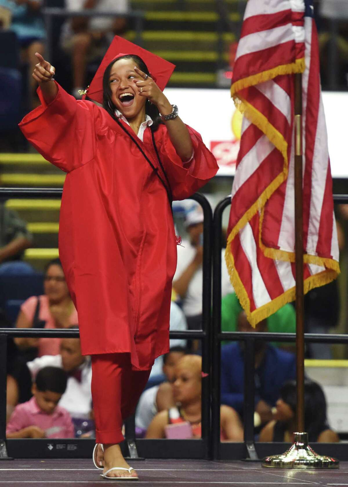 Graduating senior Mariah Wilson walks across the stage to get her diploma during the Bridgeport Central High School 2015 graduation ceremony at Webster Bank Arena in Bridgeport, Conn. Monday, June 22, 2015.