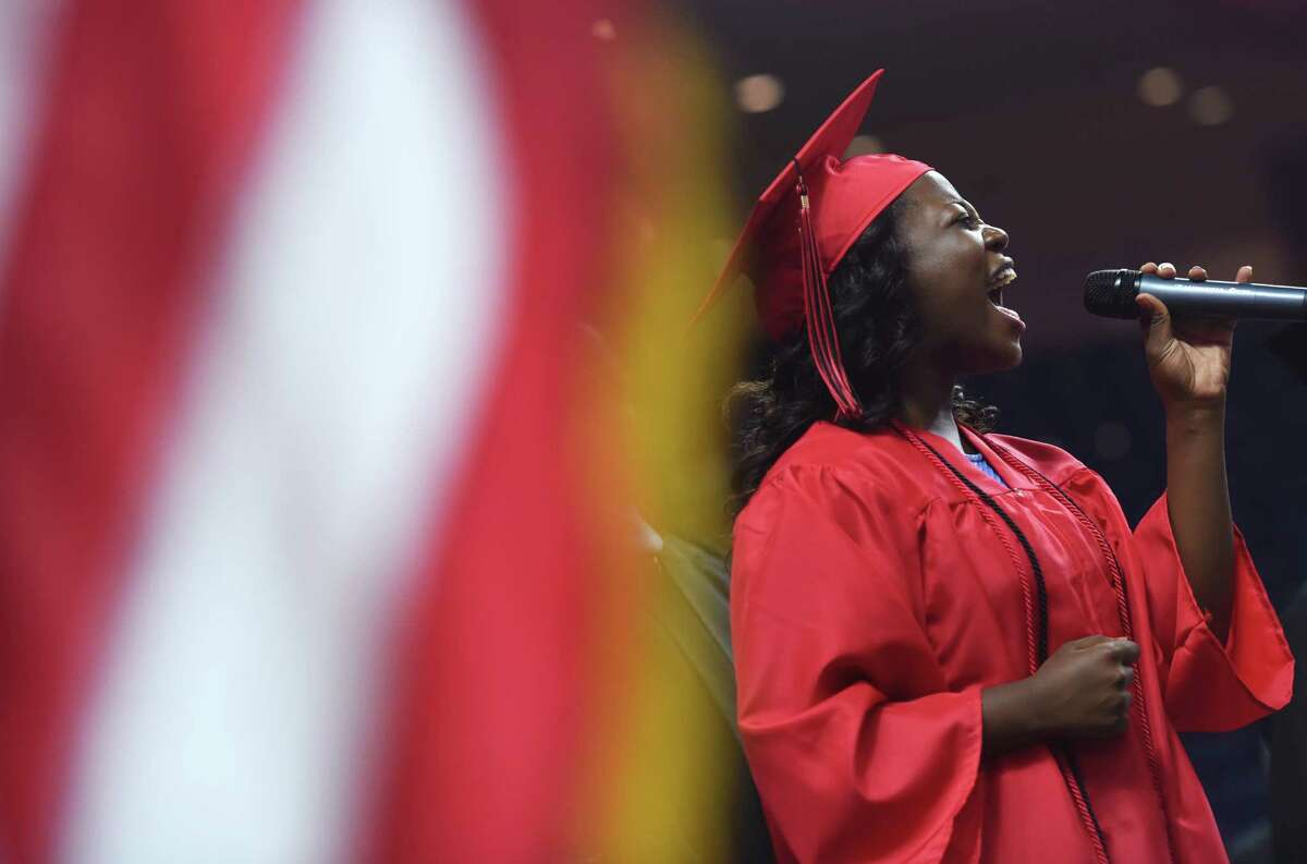 Graduating senior Mariah Lyttle sings the Star Spangled Banner before the Bridgeport Central High School 2015 graduation ceremony at Webster Bank Arena in Bridgeport, Conn. Monday, June 22, 2015.