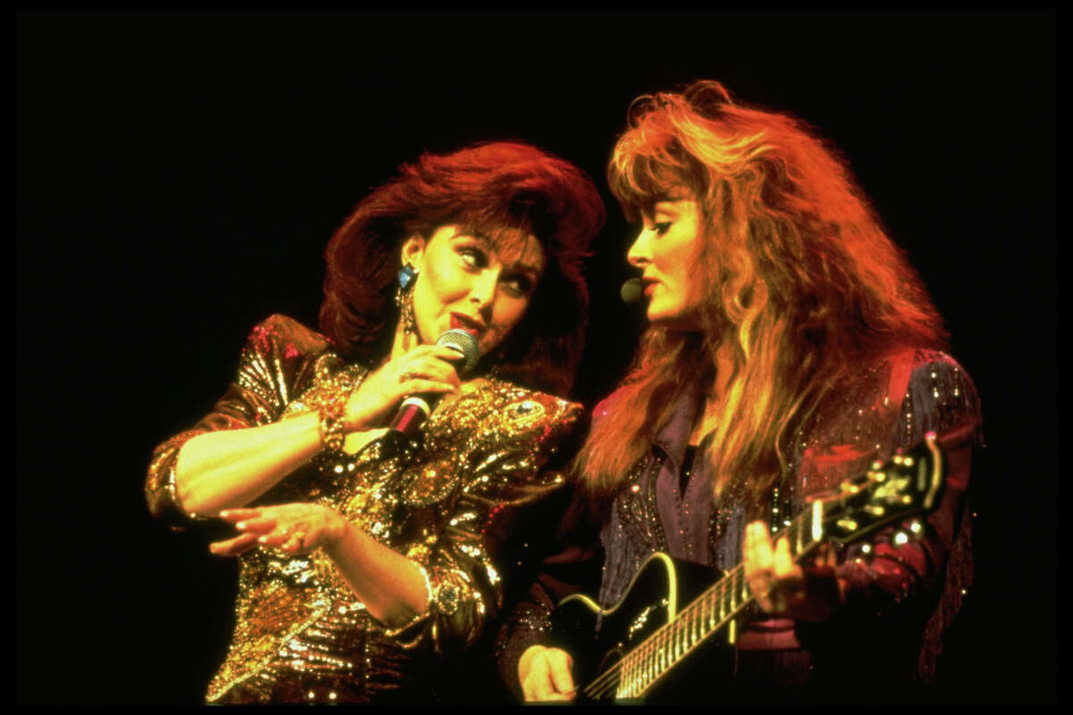 Wynonna Judd (with mother Naomi), back in the '90s. Keep clicking to see Forbes' highest paid country musicians.