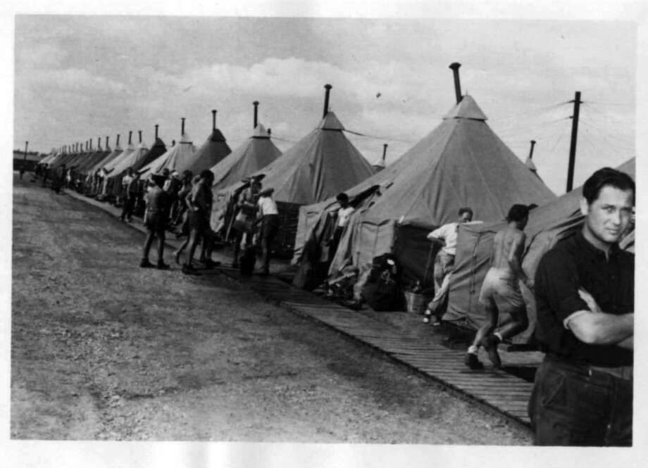 Prisoners of war (POWs), shown here in 1944, lived in squad tents in a fenced camp that was part of Dodd Field at Fort Sam Houston. The tents were set up over a wood frame on a platform; U.S. troops training in another part of the field lived under the same condition. Photo: Courtesy Fort Sam Houston Museum