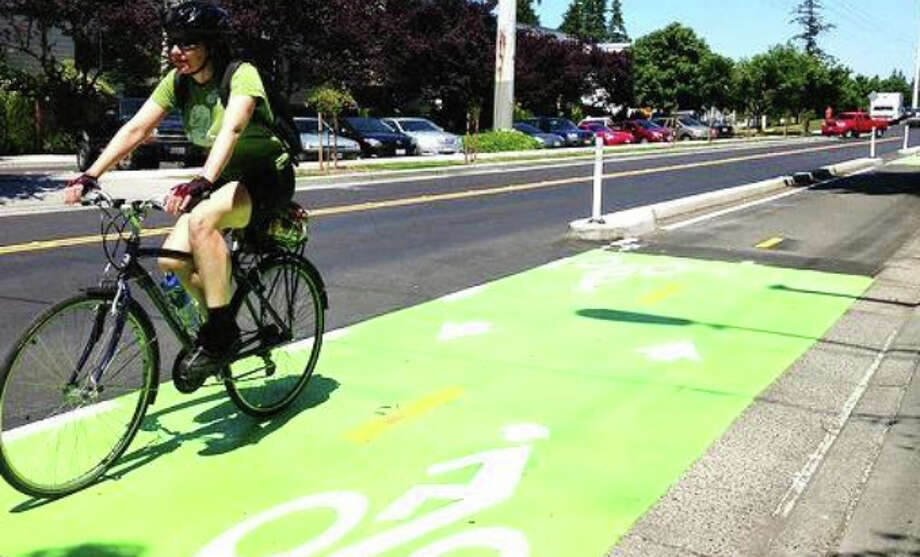 May 9 marks the sixth annual National Bike to School Day.  Click ahead to see the pros and cons of biking to work or school. Photo: City Of Seattle