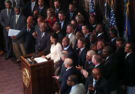 South Carolina Gov. Nikki Haley, middle, is applauded during a news conference in the South Carolina State House, Monday, June 22, 2015, in Columbia, S.C. Haley said that the Confederate flag should come down from the grounds of the state capitol, reversing her position on the divisive symbol amid growing calls for it to be removed. (Tim Dominick/The State via AP)