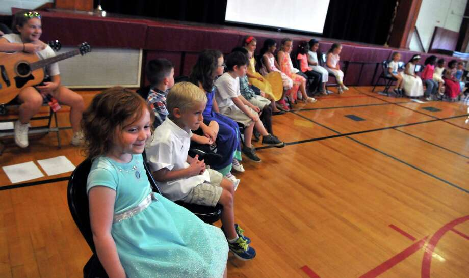 Kindergarten students wait to receive their certificates during the Moving Up Ceremony Monday, June 22, 2015, at The Menands School in Menands, N.Y. (Phoebe Sheehan/Special to the Times Union) Photo: PS / 00032306A