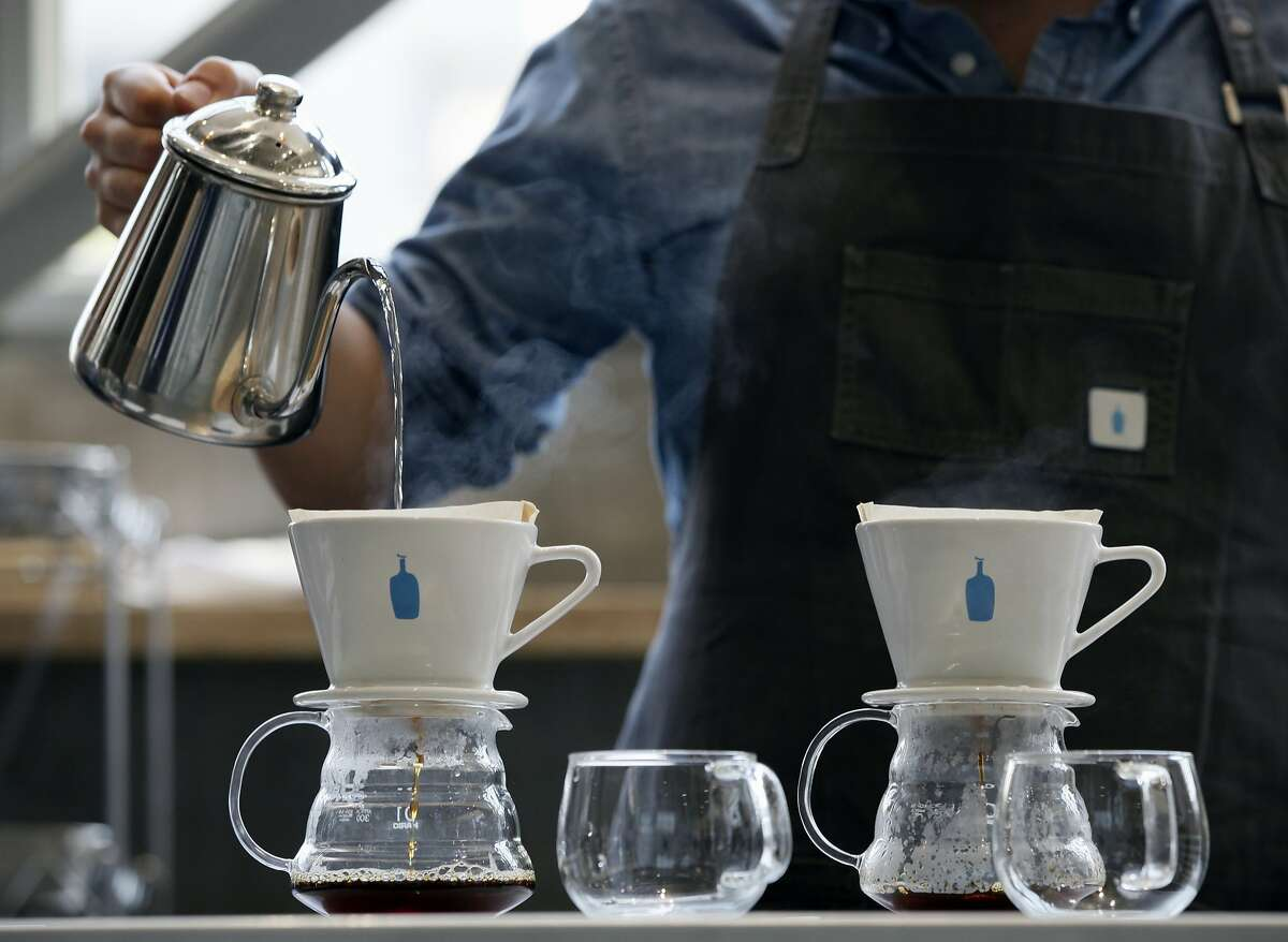 In this April 27, 2015 photo, a barista brews coffee at a Blue Bottle Coffee shop in Tokyo. Japan, famous for green tea, is welcoming artisanal American coffee roaster Blue Bottle with long lines that have at times meant a four-hour wait for a cup. The company, which began in Oakland, California in 2002, hopes its early popularity is more than a passing fad. Japan's consumer culture is littered with manias for Western food imports: pancakes, popcorn, doughnuts, even Taco Bell. (AP Photo/Shuji Kajiyama)