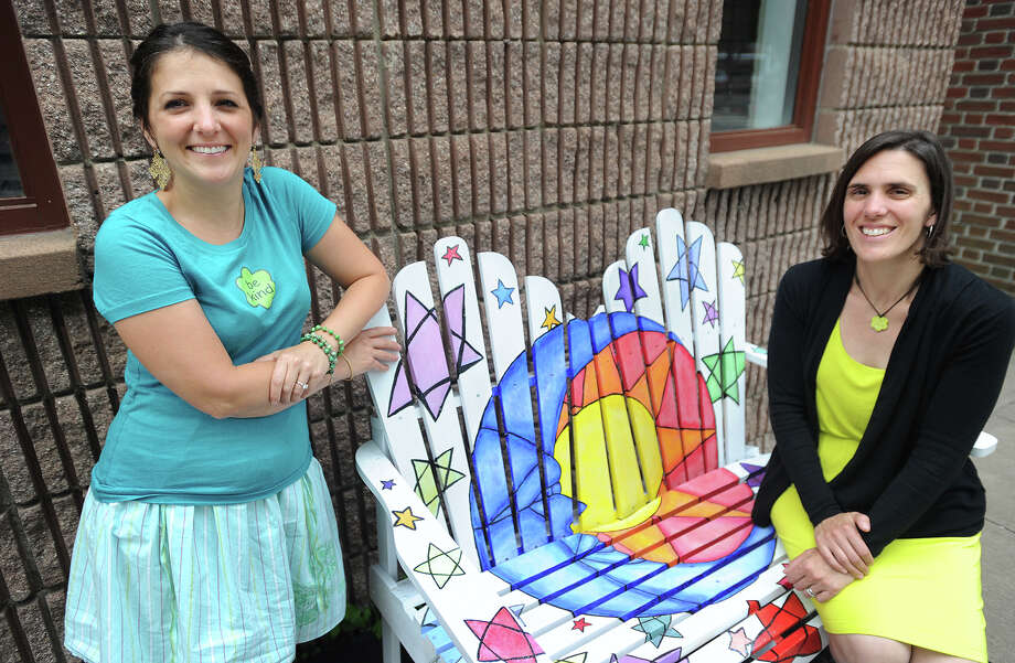 """Aubrey Booska, left, and Michelle Genuario, co-chairwomen of Stratford Street Sculpture, with a bench from the Share A Chair art exhibition. The bench, titled """"To the Moon and Back,"""" is by Stratford  artist Mary Anne Fry. Photo: Brian A. Pounds / Hearst Connecticut Media / Connecticut Post"""
